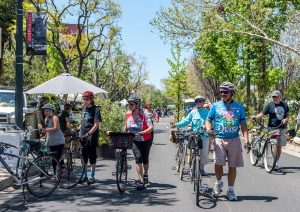 cyclists walking bikes